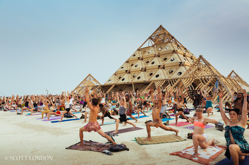 Mass Yoga outside the Temple at Burning Man, Nevada, USA